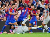 Crystal Palace defender Mamadou Sakho hacks down Mohamed Salah during the Premier League clash against Liverpool on August 20, 2018