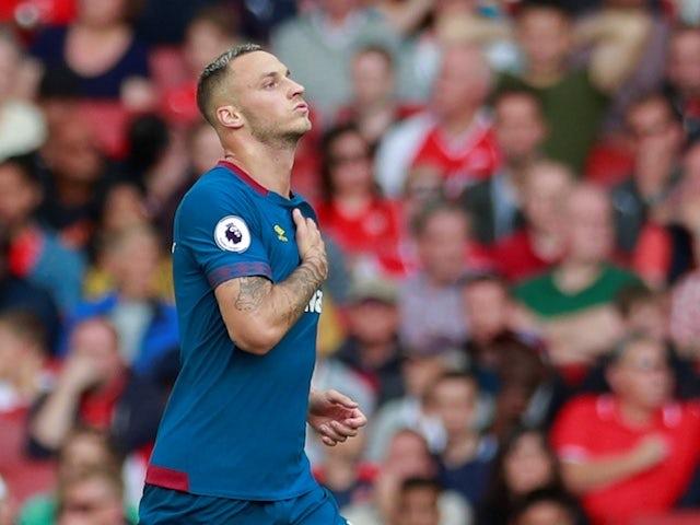 West Ham United striker Marko Arnautovic celebrates scoring against Arsenal at the Emirates Stadium on August 25, 2018