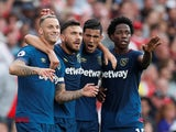West Ham United striker Marko Arnautovic celebrates with teammates after scoring against Arsenal at the Emirates Stadium on August 25, 2018