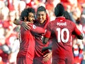 Liverpool striker Mohamed Salah celebrates with Roberto Firmino and Sadio Mane after opening the scoring during his side's Premier League clash with Brighton & Hove Albion on August 25, 2018