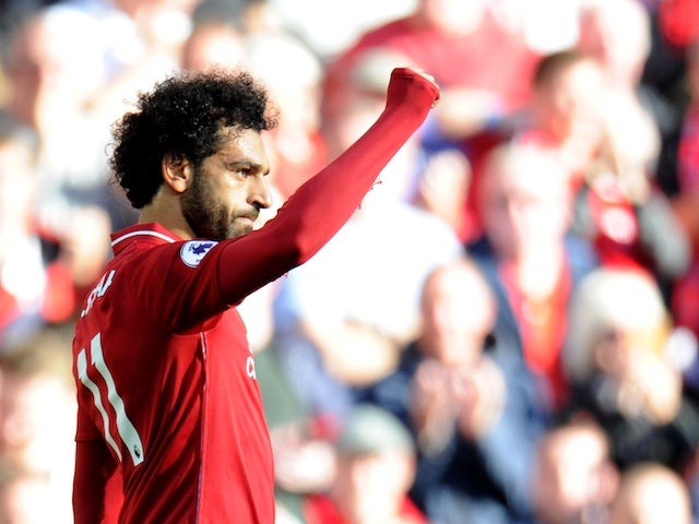 Liverpool striker Mohamed Salah celebrates opening the scoring during his side's Premier League clash with Brighton & Hove Albion on August 25, 2018