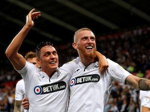 Championship roundup: Swans end 100% Leeds start