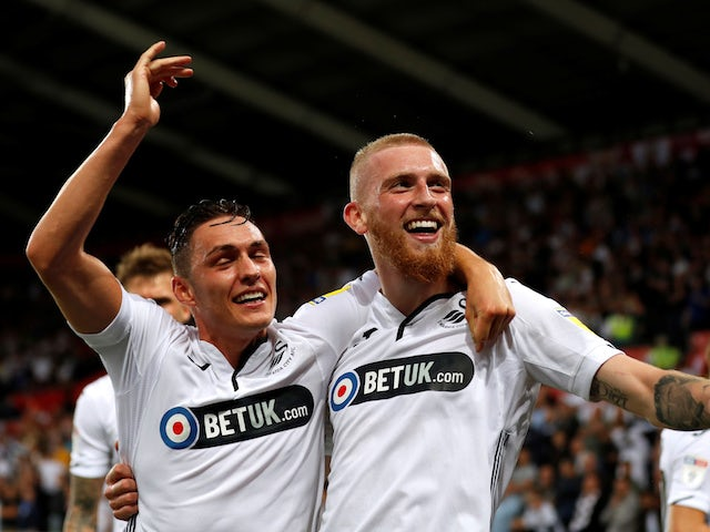 Ollie McBurnie celebrates scoring for Swansea City against Leeds United on August 21, 2018