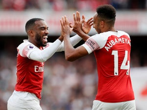 Pierre-Emerick Aubameyang and Alexandre Lacazette celebrate Arsenal's second goal against West Ham United on August 25, 2018