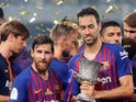 Barcelona midfielder Sergio Busquets with Lionel Messi after his side's Spanish Super Cup win in August 2018