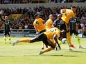 Wolverhampton Wanderers defender Willy Boly scores with his arm during their Premier League clash with Manchester City on August 25, 2018