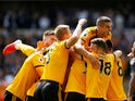 Wolves players celebrate Willy Boly's goal during their Premier League clash with Manchester City on August 25, 2018
