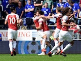 Shkodran Mustafi celebrates with his Arsenal teammates after opening the scoring against Cardiff City on September 2, 2018