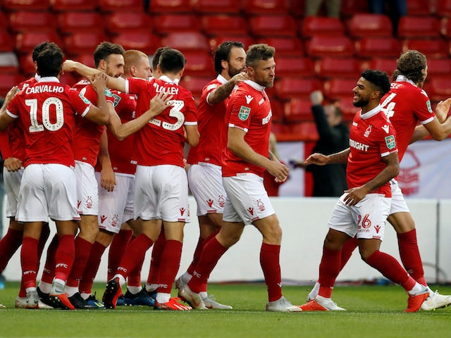 Nottingham Forest striker Daryl Murphy celebrates with teammates after scoring during his side's EFL Cup clash with Newcastle United on August 29, 2018