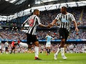 DeAndre Yedlin celebrates with Newcastle United teammate Salomon Rondon after equalising against Manchester City on September 1, 2018