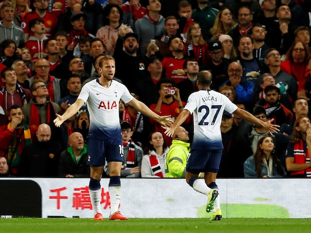 Tottenham Hotspur striker Harry Kane celebrates with Lucas Moura after scoring his side's opening goal during their Premier League clash with Manchester United on August 27, 2018