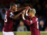 Javier Hernandez celebrates scoring West Ham United's third goal against AFC Wimbledon with Issa Diop on August 28, 2018