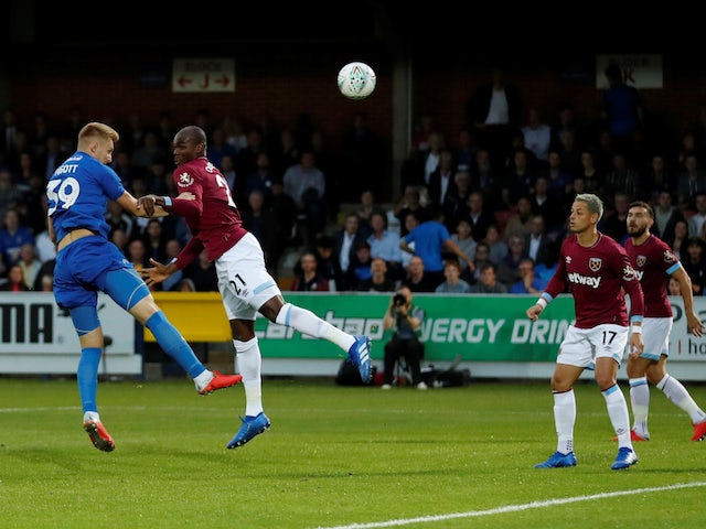 Joe Pigott scores the opener during the EFL Cup second-round game between AFC Wimbledon and West Ham United on August 28, 2018