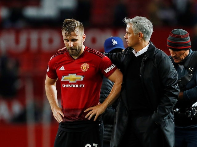 Manchester United manager Jose Mourinho consoles Luke Shaw after his side's defeat to Tottenham Hotspur on August 27, 2018