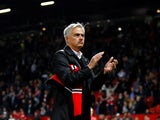 Manchester United manager Jose Mourinho applauds supporters following his side's 3-0 defeat at home to Tottenham Hotspur on August 27, 2018