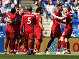 Roberto Firmino celebrates with his Liverpool teammates during his side's Premier League clash with Leicester City on September 1, 2018