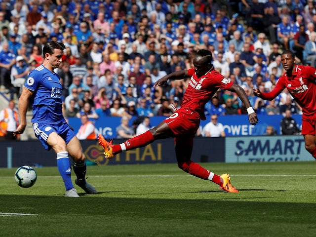 Liverpool striker Sadio Mane scores the opening goal during his side's Premier League clash with Leicester on September 1, 2018