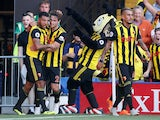 Watford striker Troy Deeney celebrates scoring against Tottenham Hotspur on September 2, 2018