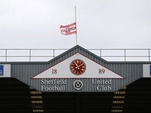 Jones axed by Sheffield United after racial abuse