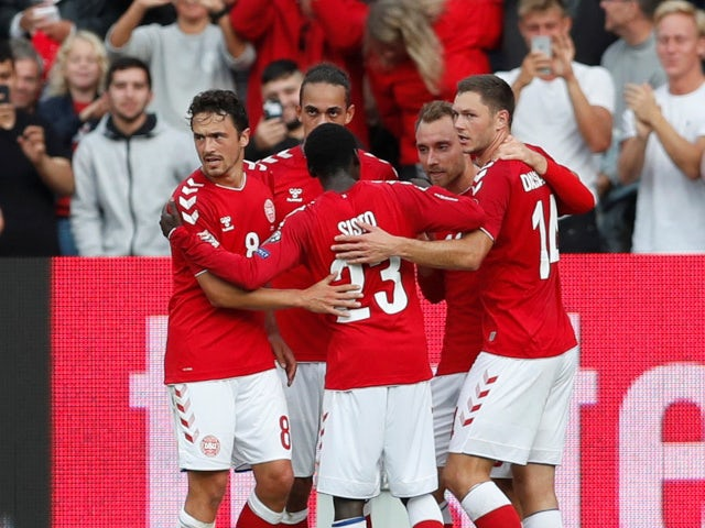Denmark's Christian Eriksen celebrates with his teammates after scoring his side's opener against Wales on September 9, 2018