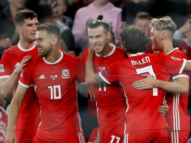 Wales forward Gareth Bale celebrates with teammates during his side's UEFA Nations League clash with Republic of Ireland on September 6, 2018