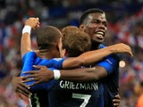 Kylian Mbappe celebrates scoring France's first goal against Netherlands with Paul Pogba and Antoine Griezmann on September 9, 2018