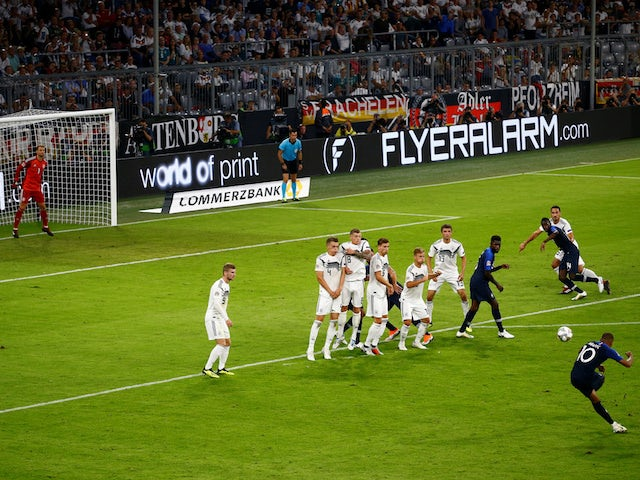 France forward Kylian Mbappe goes for goal with a free kick during his side's UEFA Nations League clash with Germany on September 6, 2018