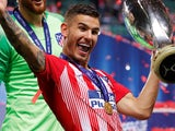 Lucas Hernandez celebrates winning the Supercopa de Espana with Atletico Madrid on August 15, 2018