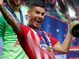 Lucas Hernandez celebrates winning the Supercopa de Espana with Atletico Madrid on August 15, 2018