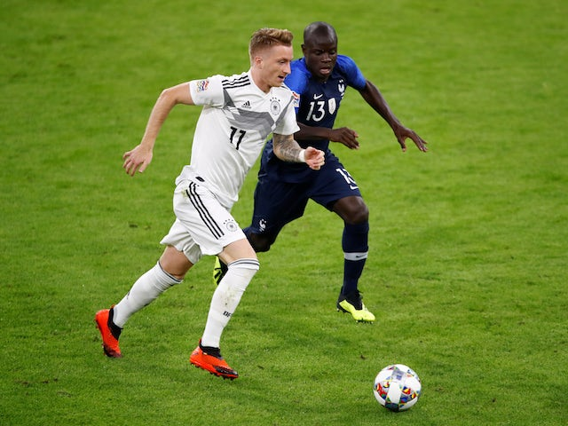 Germany's Marco Reus in action with France's N'Golo Kante on September 6, 2018