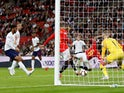 Spain's Rodrigo scores their second goal past England's Jordan Pickford during the UEFA Nations League match on September 8