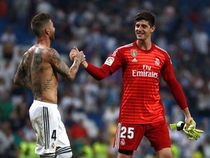 Real Madrid's Thibaut Courtois and Sergio Ramos shake hands on September 1, 2018