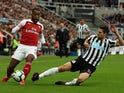 Alexandre Lacazette and Federico Fernandez in action during the Premier League game between Newcastle United and Arsenal on September 15, 2018