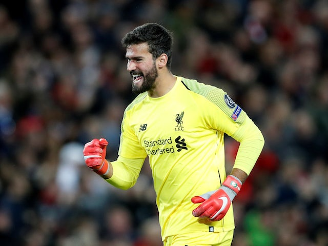 Alisson celebrates the first goal during the Champions League group game between Liverpool and Paris Saint-Germain on September 18, 2018