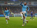 Bernardo Silva celebrates scoring during the Premier League game between Cardiff City and Manchester City on September 22, 2018