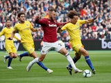 David Luiz and Andriy Yarmolenko in action during the Premier League game between West Ham United and Chelsea on September 23, 2018