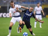 Eric Dier and Radja Nainggolan in action during the Champions League group game between Inter Milan and Tottenham Hotspur on September 18, 2018