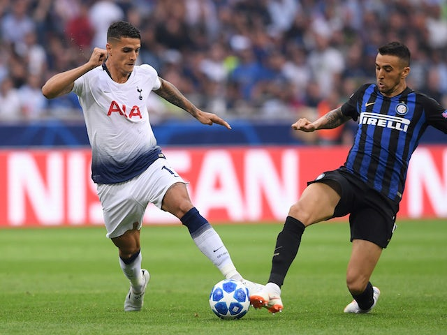 Erik Lamela and Matias Vecino in action during the Champions League group game between Inter Milan and Tottenham Hotspur on September 18, 2018