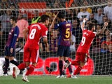 Girona players celebrate after scoring against Barcelona on September 23, 2018