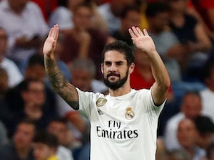 Real Madrid midfielder Isco celebrates scoring during his side's Champions League clash with Roma on September 19, 2018