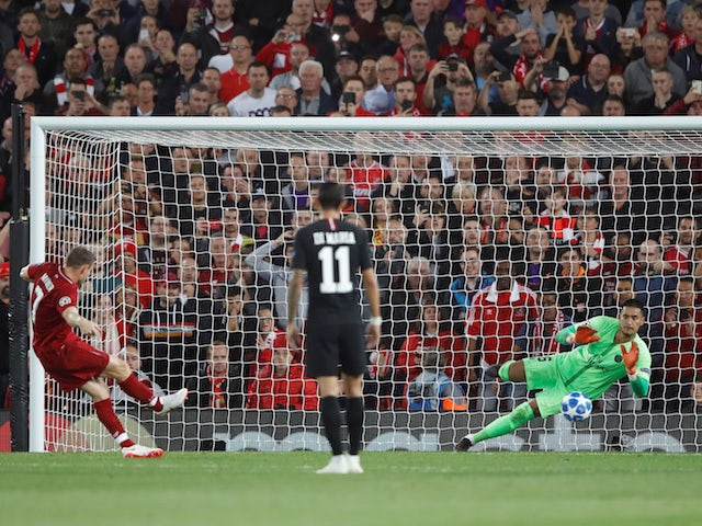 James Milner sends in the second from the spot during the Champions League group game between Liverpool and Paris Saint-Germain on September 18, 2018