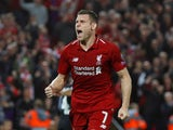 James Milner celebrates scoring the second during the Champions League group game between Liverpool and Paris Saint-Germain on September 18, 2018