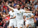 Joao Moutinho celebrates a glorious equaliser during the Premier League game between Manchester United and Wolverhampton Wanderers on September 22, 2018