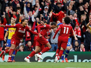 Joel Matip celebrates scoring during the Premier League game between Liverpool and Southampton on September 22, 2018