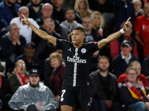 Kylian Mbappe celebrates his late goal during the Champions League group game between Liverpool and Paris Saint-Germain on September 18, 2018