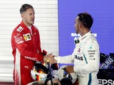 Lewis Hamilton shakes hands with Sebastian Vettel at the Singapore Grand Prix on September 16, 2018