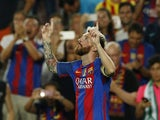 Lionel Messi celebrates scoring a hat-trick against Celtic in September 2016