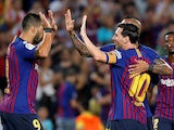Barcelona forward Lionel Messi celebrates with teammates after scoring during his side's La Liga match against Girona on September 23, 2018