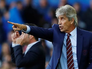 West Ham United manager Manuel Pellegrini gestures on September 16, 2018