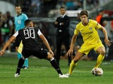 Marcos Alonso and Leo Jaba in action during the Europa League group game between PAOK and Chelsea on September 20, 2018